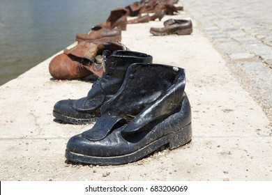 Shoes monument on the Danube bank is a memorial in Budapest, Hungary. Place of reverence. Black and white photo. Symbolic artistic object.