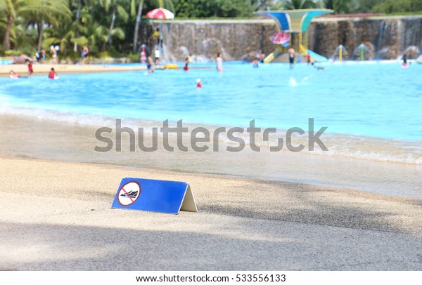 shoes are not allowed on the beach symbol on swimming pool background , Siam park center are Asia's biggest water park in thailand