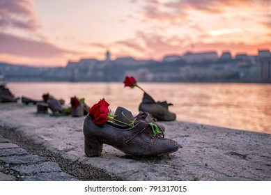 """Shoes on the Danube bank"" - Monument as a memorial of the victims of the Holocaust during WWII on the bank of the Danube at sunset in Budapest, Hungary"