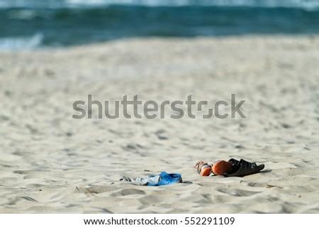 4bce5cf36 Shoes On Empty Beach Stock Photo (Edit Now) 552291109 - Shutterstock