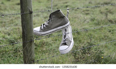 Shoes on fence, Ameland, Dutch