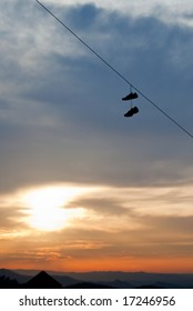 Shoes on hanging on a power line