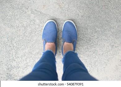 shoes on urban grunge background of asphalt