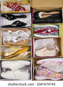 a lot of shoes in open boxes