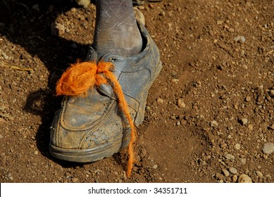 shoes of a poor child
