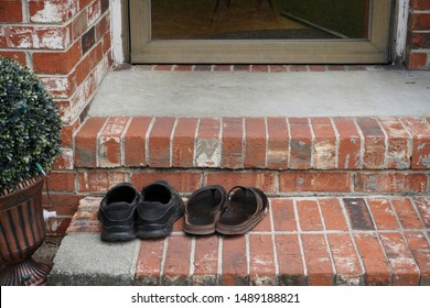 Shoes removed from feet before entering a residence or house out of courtesy.