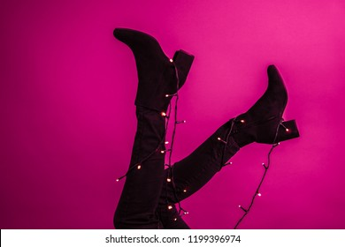 Shoes with shining christmas lights around them