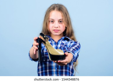 Shoes shop. Fashion store. Play with moms shoes. Every girl dreaming about fashionable high heels. Little fashionista with high heels. Boutique concept. Excited about high heels. Female attribute.