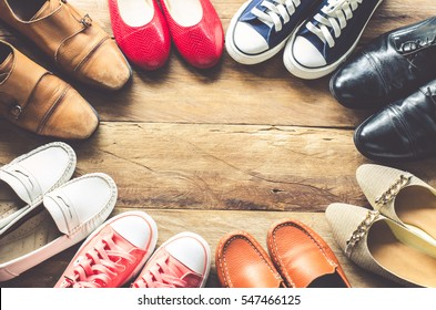 Photo of shoes various styles  on a wooden floor - lifestyles.