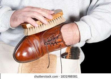 A shoeshine man polishing a leather dress shoe