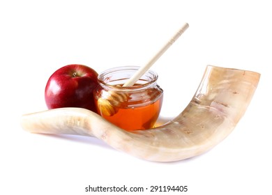 shofar (horn), honey, apple isolated on white. rosh hashanah (jewish holiday) concept . traditional holiday symbol.
