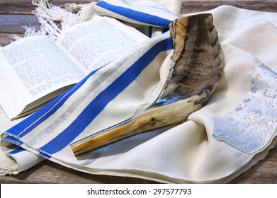 shofar (horn) on white prayer talit. room for text. rosh hashanah (jewish holiday) concept . traditional holiday symbol.