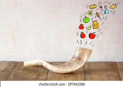 shofar (horn) on wooden table with set of infographics over textured background. rosh hashanah (jewish holiday) concept . traditional holiday symbol.
