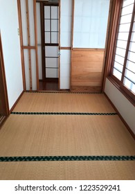 Shoji window decoration and tatami mattress in Japanese room, Japanese architecture for door or window for room divider consisting of translucent paper over a frame of wood