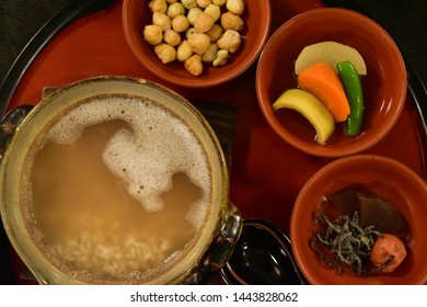 """Shojin Ryori"" Japan's Sophisticated Buddhist Cuisine. in Nara Japan. Chagayu(voiled rice) Arare (Rice crackers) Yasai no Nimono(Stewed Vegetables) and Tsukemono (Japanese pickles"