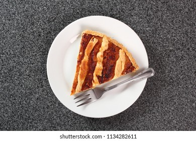 Shoofly Tart with Golden Syrup Filling on Granite Surface