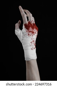 shook his bloody hand in a bandage, bloody bandage, fight club, street fight, violence, bloody theme, black background, isolated, bloody fists, boxer, tied his hands with a bandage