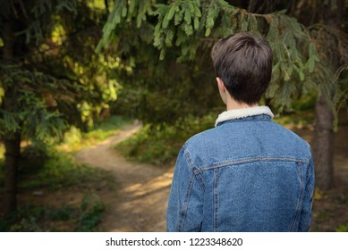 Shoot From Behind Teenager boy in forest