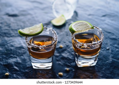 Shoot glass of liqour with salt and lime