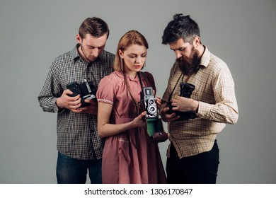 Shoot smart school. Retro style woman and men hold analog photo cameras. Paparazzi or photojournalists with vintage old cameras. Group of photographers with retro cameras. Photography studio.