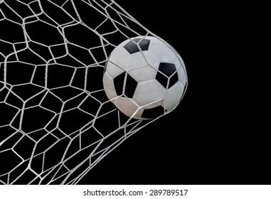 Shoot soccer ball in goal, net on black isolated background.