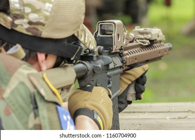 Shooter aiming target with assault rifle weapon