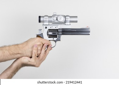 Shooter holds .357 Magnum revolver with dot sight