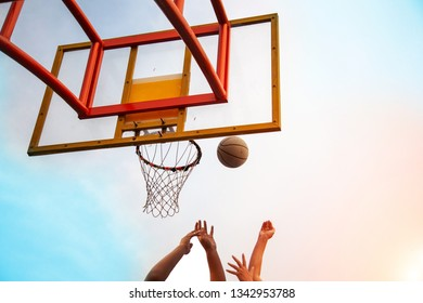 shooting ball play basketball game outdoor court. outdoor sport game with ball and basket on sky