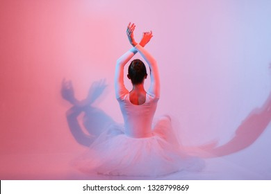 Shooting a ballerina on a cyclorama with pulsed light