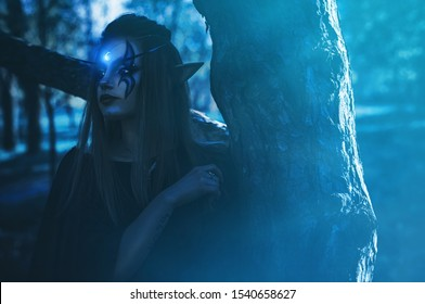 shooting cosplay girl elf in the forest