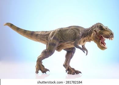 shooting dinosaur model on blue background