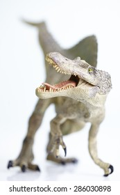 shooting dinosaur model on white background
