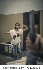 Shooting a female zombie inside an abandoned building