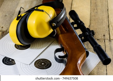shooting, pneumatic and firearms on a wooden table. Table on the shooting range, weapons and shooting accessories. black background