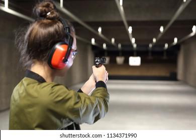 Shooting range. Shooting with a gun. Measuring to a paper target on the shooting range.