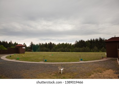 Shooting range for skeet - shelters for throwing machines on sides