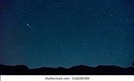 Shooting star (Perseids meteor shower) near the Big Dipper (Plough), with Ursa Minor and north star visible, Zuoz, Engadine, Switzerland.