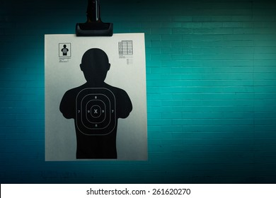 Shooting target hanging on a grungy background