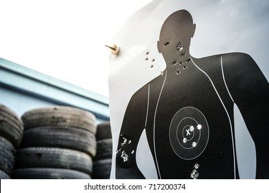 Shooting target paper in the shooting range with bullets hole.