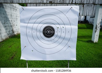 Shooting target in shooting range.Bullets marks on paper target.