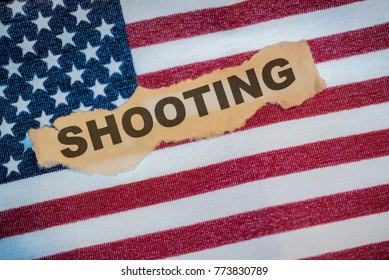 Shooting text word laying on the American Flag