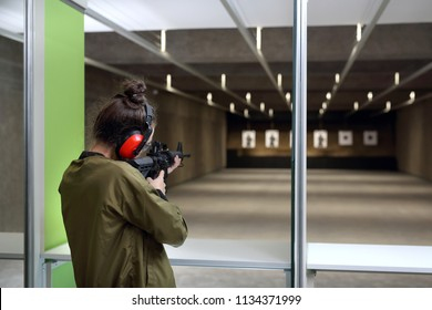 Shooting training. A woman at the shooting range.