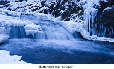 Shooting the winter waterfall