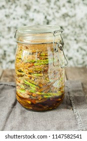 Shoots of pine syrup in glass jar