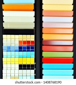 Shop of decorative materials, warehouse of ceramic products. Catalog tiled, samples in the store to choose from
