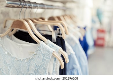 Shop with different clothes shopping, racks and shelves