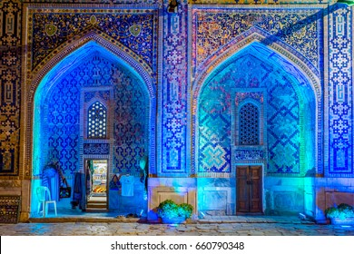 Shop in lit up atrium of Sher Dor madrasah at night, Registan, Samarkand, Uzbekistan