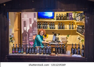 a shop with Madeira Wine at the market street at the avenida Arriaga at the Festa da Flor or Spring Flower Festival in the city of Funchal on Madeira of Portugal.  Madeira, Funchal, April, 2018