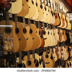 shop of many classic wood guitar background, pop rock artist song music and entertainment instrument concert