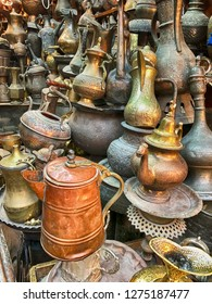 A shop in the Old City of Jerusalem displays a number of kettles and teapots of different sizes.